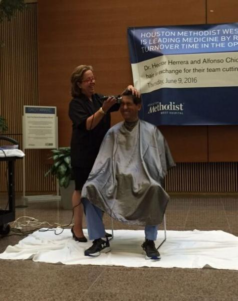 Dr. Herrera gets his head shaved