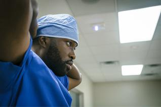 Close-up of surgeon tying surgical hat
